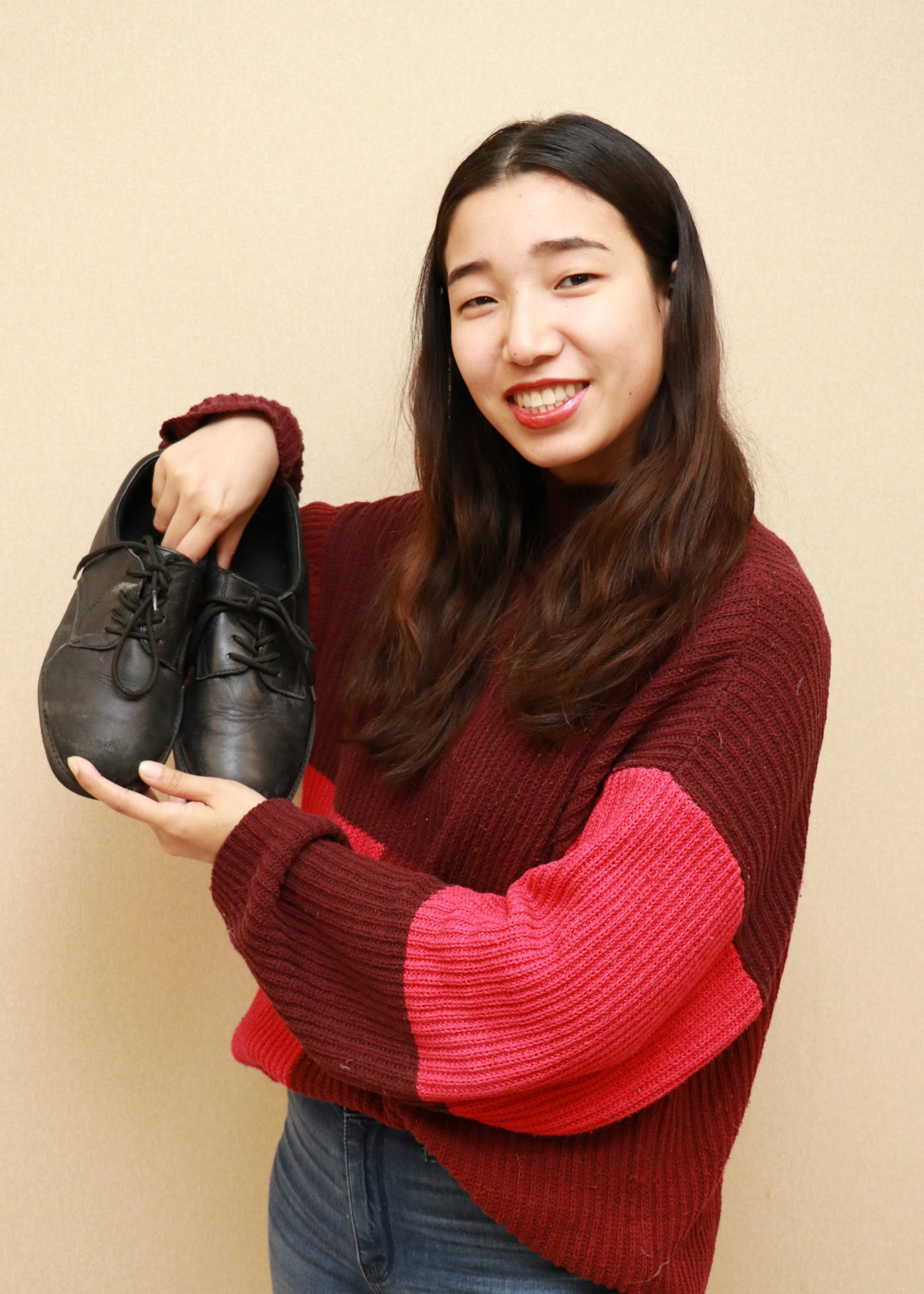 Choden holding her bata shoes